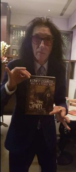 John Cooper-Clark with his copy of A Crafty Cigarette